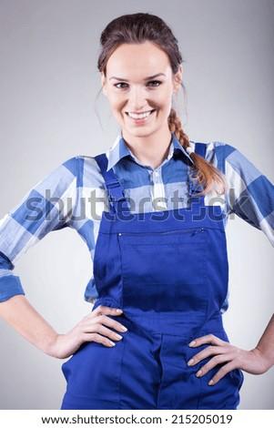 Beautiful young woman portrait in handyman blue dress - stock photo