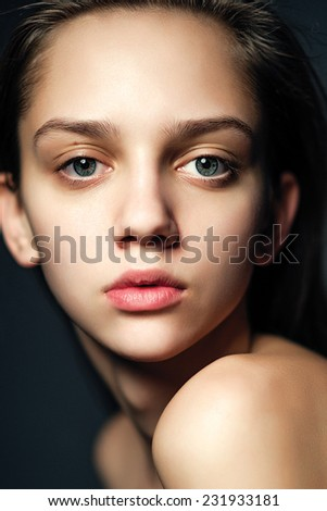 Beautiful Young Woman Portrait looking in the camera in studio