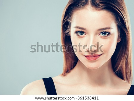 Beautiful young woman portrait smiling posing attractive - stock photo
