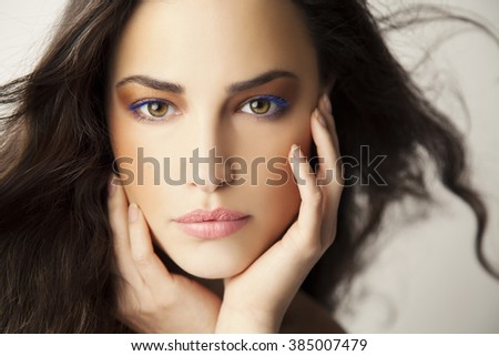beautiful young woman portrait, studio closeup