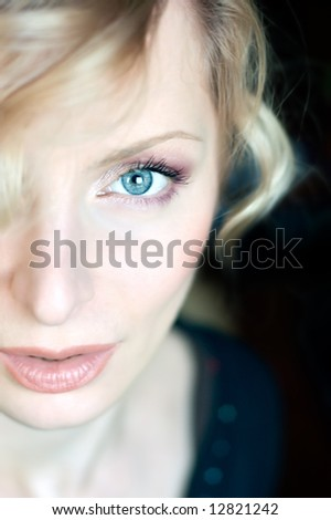 Beautiful young woman portrait with blue eyes - stock photo