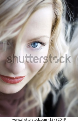 Beautiful young woman portrait with blue eyes and red lips - stock photo