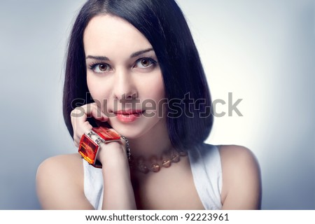beautiful young woman portrait with brunette hair in motion, studio shot - stock photo