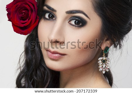 beautiful young woman portrait with rose black hair and bright smoky makeup
