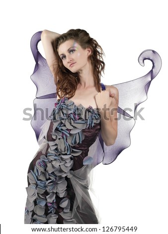Beautiful young woman posing in a fairy costume on white background - stock photo