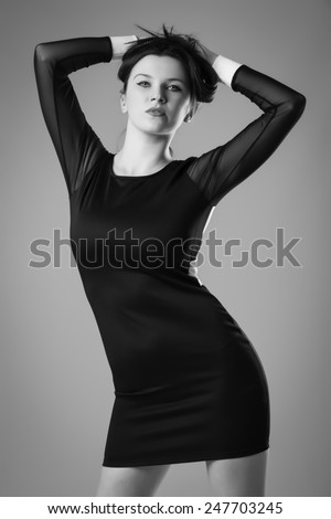 Beautiful Young Woman Posing in Little Black Dress - stock photo
