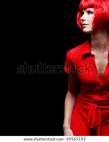 Beautiful young woman posing in red dress. - stock photo
