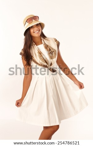 Beautiful young woman posing in summer dress and hat, smiling happy. - stock photo