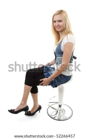 beautiful young woman posing on crutch  over white background