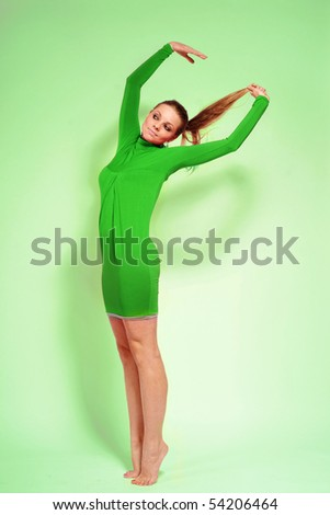 beautiful, young woman posing on green background - stock photo
