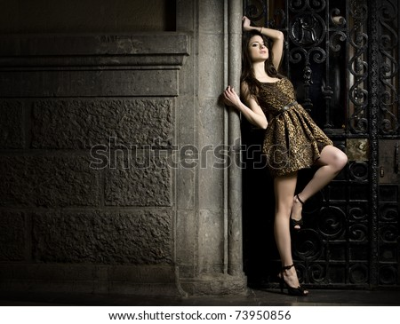 beautiful young woman posing outdoors during a fashion shooting - stock photo