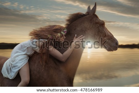 Beautiful young woman posing with a horse