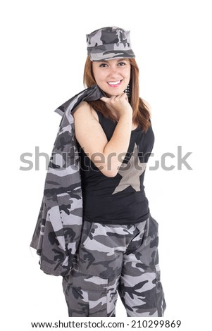 Beautiful young woman posing with gray military uniform carrying jacket over her shoulder isolated on white