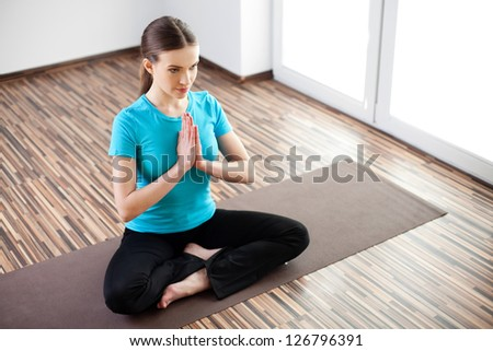 Beautiful young woman practicing at home - stock photo