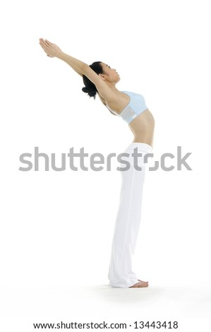 Beautiful young woman practicing yoga - stock photo
