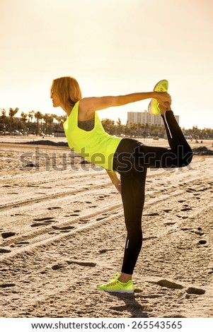 Beautiful young woman practicing yoga on the beach. Natarajasana, This aesthetic, stretching and balancing asana is used in Indian classical dances. - stock photo