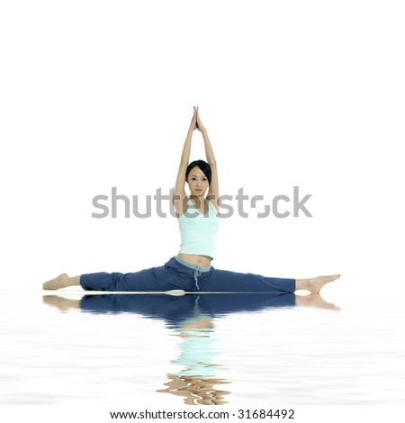 beautiful young woman practicing yoga with reflection - stock photo