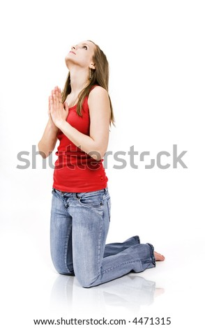 Beautiful young woman praying and looking up - stock photo