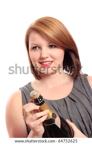 Beautiful young woman preparing for a celebration, opening a bottle of champagne