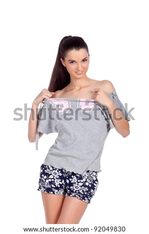 Beautiful young woman pulling off her 58 t-shirt.  High resolution image taken in studio. Isolated on pure white background with copy space for your ad. - stock photo