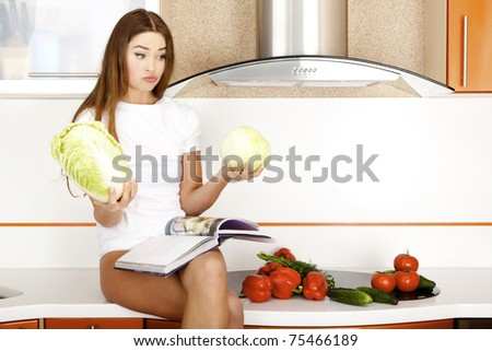 beautiful young woman ready to prepare salad - stock photo
