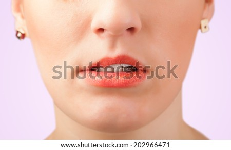 Beautiful young woman red lips close up  - stock photo