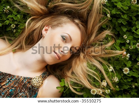 Beautiful young woman relaxing at park - stock photo