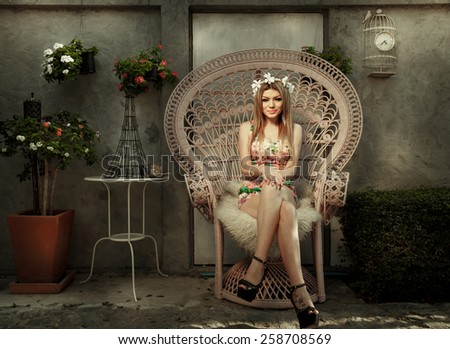 Beautiful Young Woman Relaxing At Pink Chair In The Garden With Vintage Retro Scene - stock photo