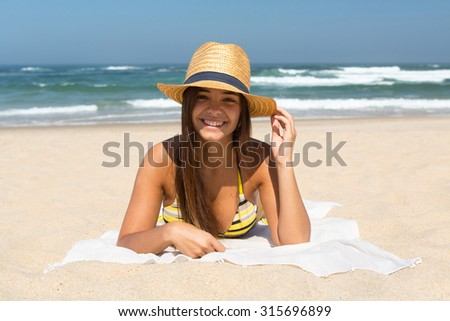 Beautiful young woman relaxing at the beach - stock photo