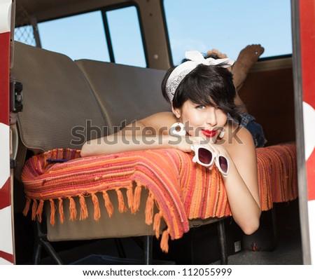 Beautiful young woman relaxing in - stock photo