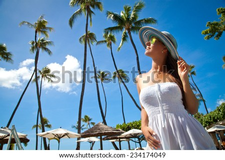 Beautiful young woman relaxing in luxury hotel. Feeling relaxed and naturally gorgeous in summer vacation, Hawaii - stock photo