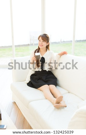 Beautiful young woman relaxing in the room - stock photo