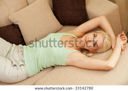 Beautiful young woman relaxing on a sofa