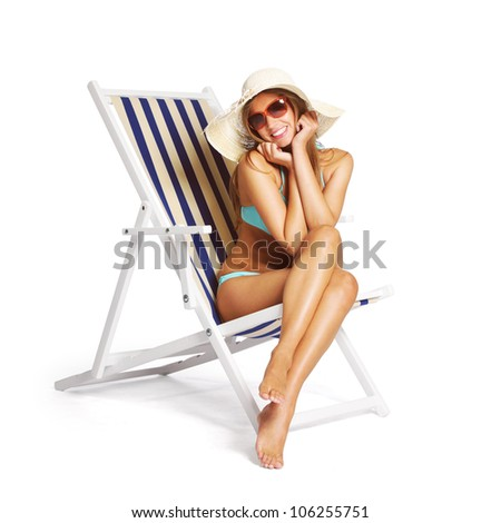 Beautiful young woman relaxing on beach chair, white background - stock photo