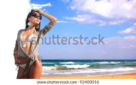 Beautiful young woman relaxing on the beach - Travel concept