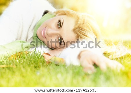 Beautiful young woman relaxing outdoors. - stock photo