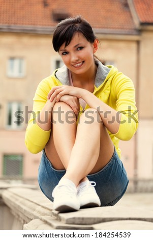 beautiful  young woman resting outdoors, smiling - stock photo