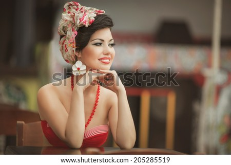 beautiful young woman retro pin up portrait, summer girl at beach cafe vintage lifestyle. Woman at vacation Cuba. series. soft retro tonality.  - stock photo