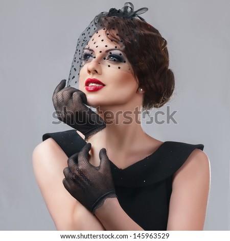 Beautiful young woman retro style studio portrait - stock photo