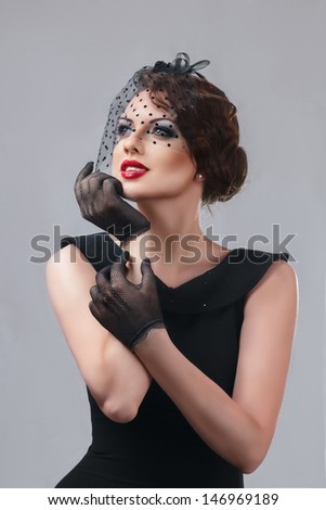 Beautiful young woman retro style studio portrait