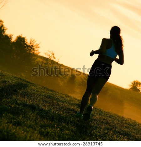 Beautiful young woman runner having a workout session. - stock photo