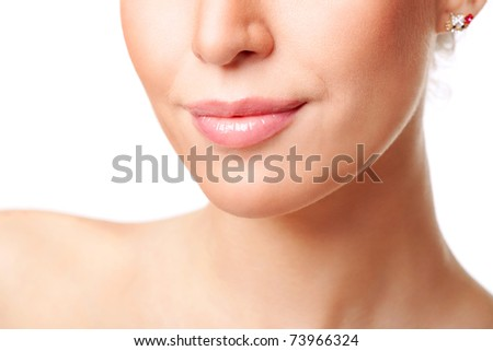 Beautiful young woman's face fragment with natural smile. Isolated on white - stock photo