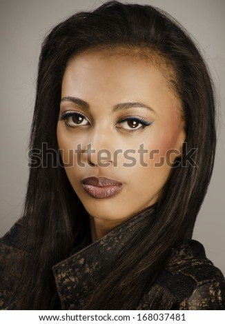 Beautiful young woman's face with fresh clean skin and hair - stock photo