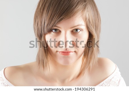 beautiful young woman's  studio portrait  - stock photo