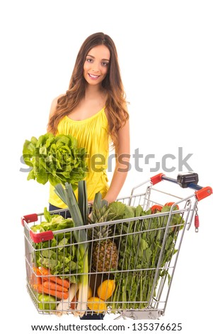 Beautiful young woman shopping at the supermarket