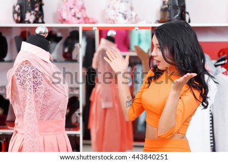 Beautiful young woman shopping in a clothing store