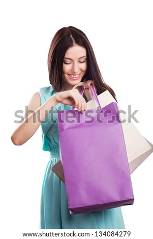 Beautiful young woman shopping, isolated on white background - stock photo