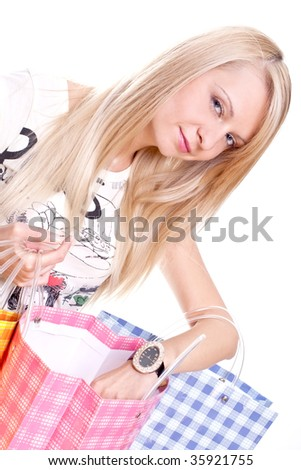 beautiful young woman shopping on a white background