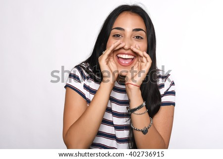 Beautiful young woman shouting and screaming. Isolated white background. - stock photo