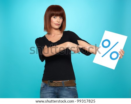 beautiful, young woman showing a percent sign, on blue background - stock photo